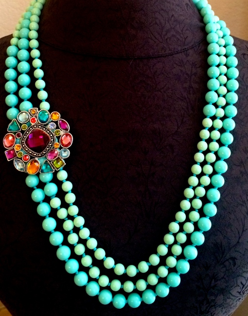 Seabreeze  necklace offers so much fashion function.  Pull in a pop of color with the Hidden Gems brooch. Lady like look for spring.