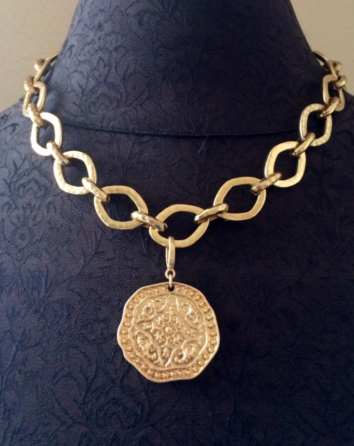 Add the gold coin charm from the Pompeii necklace to the Golden Rule necklace.  Classic look!!