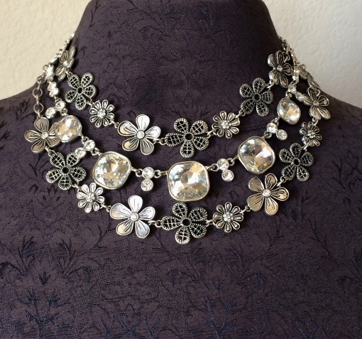 The Most Wanted necklace is nested between the Daisy chain doubled.