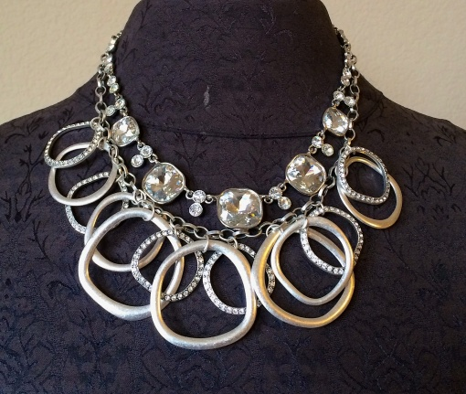 The Most Wanted necklace framed with the Round About necklace