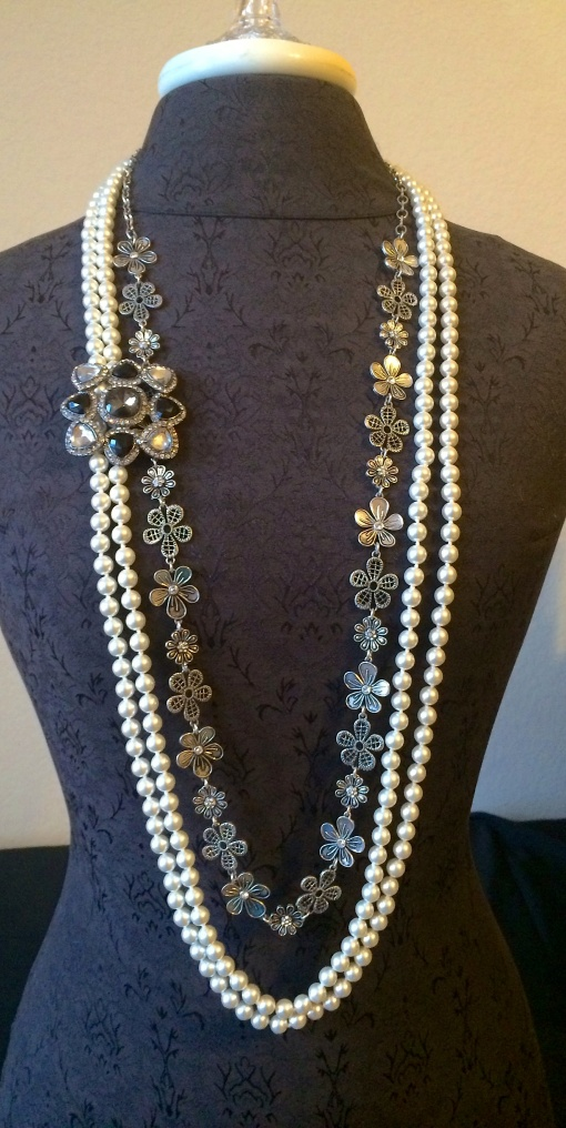 The Daisy chain worn long and framed by the Opening NIght's necklace doubled.  The Royal Dreams  is pinned on the side to complete this elegant look.