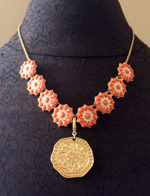 Add the gold coin from the Pompeii necklace to the Peachy Keen necklace.